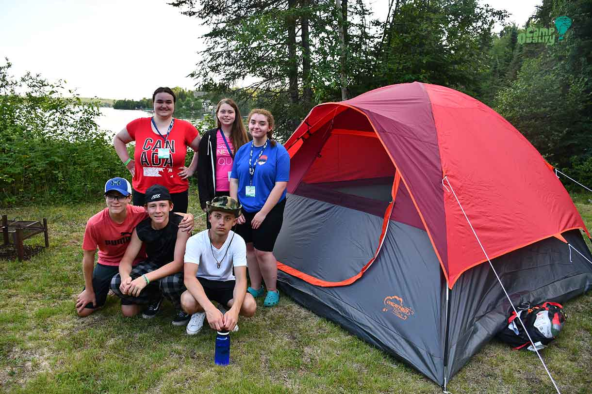 Some of our teen campers showing off the tent they put their blood, sweat and tears into. (Back, from left: Campers Alyx, Katelyn and Isabella. Front, from left: Noah, Zeke and Connor.)