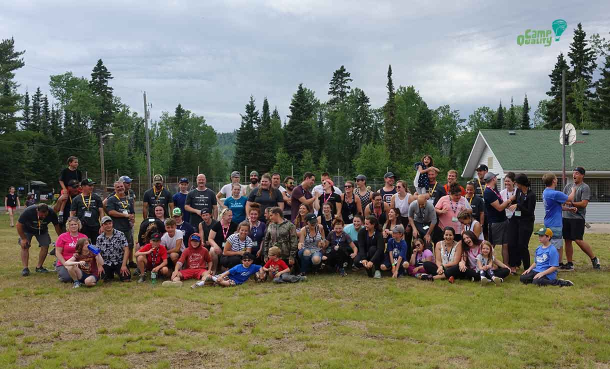 Camp Quality volunteers and campers pose with the Thunder Bay Police for a group photo after our epic soccer game.