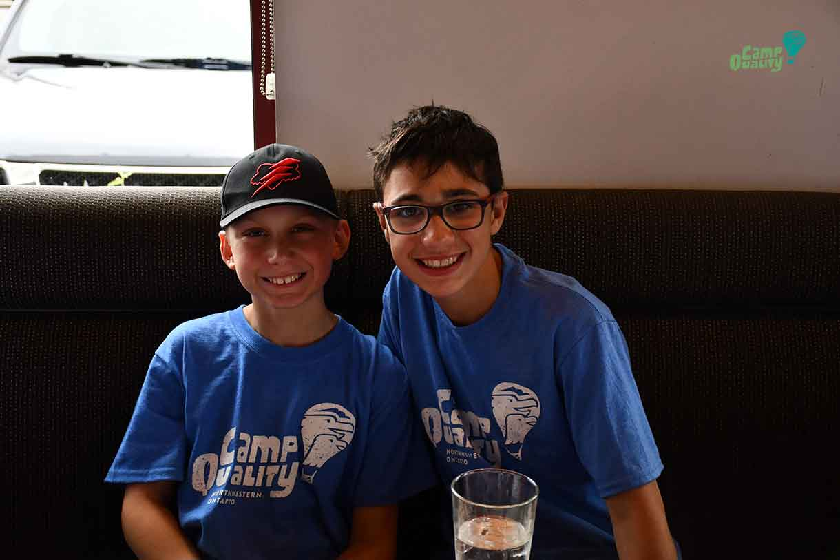 Campers Denver and Lucas enjoying their meal from Boston Pizza.
