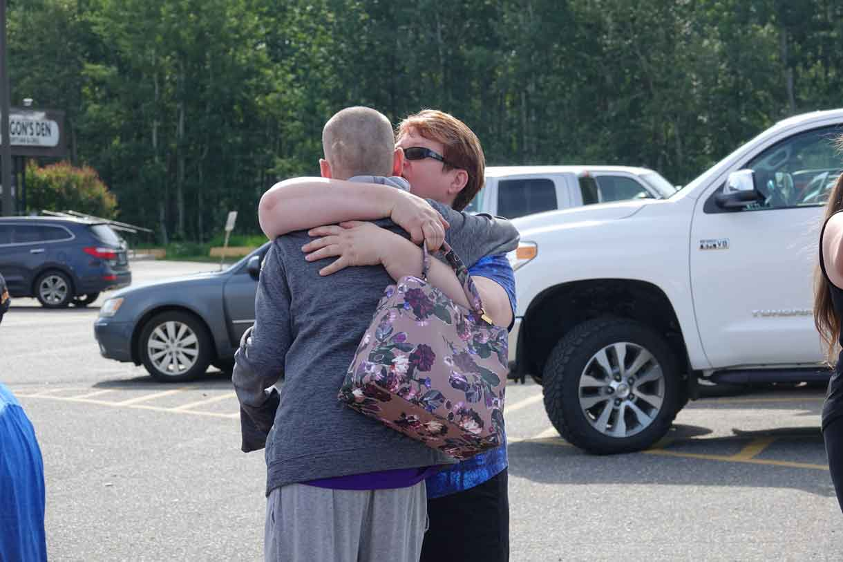 Camper Alex saying goodbye to his mom, Cathy at camp pick-up.