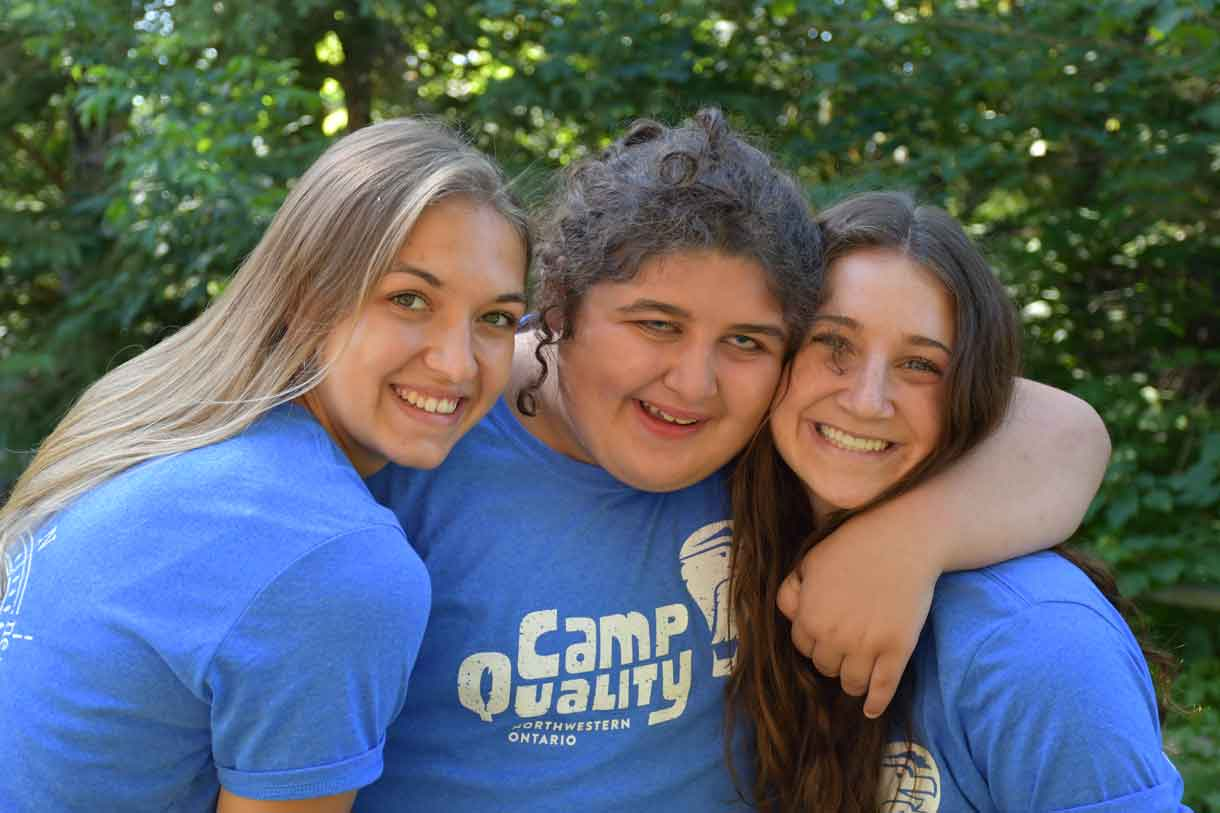 Camper Danica (middle) with Companions Paige (left) and Jacqueline, sporting their blue camp T-shirts
