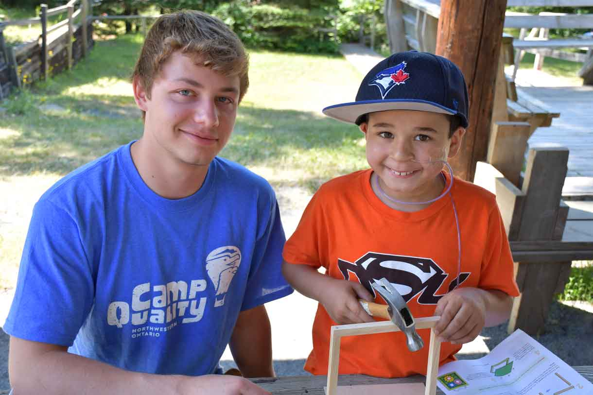 Camper Alessio (right) building a Home Depot craft with Companion Branden (left)