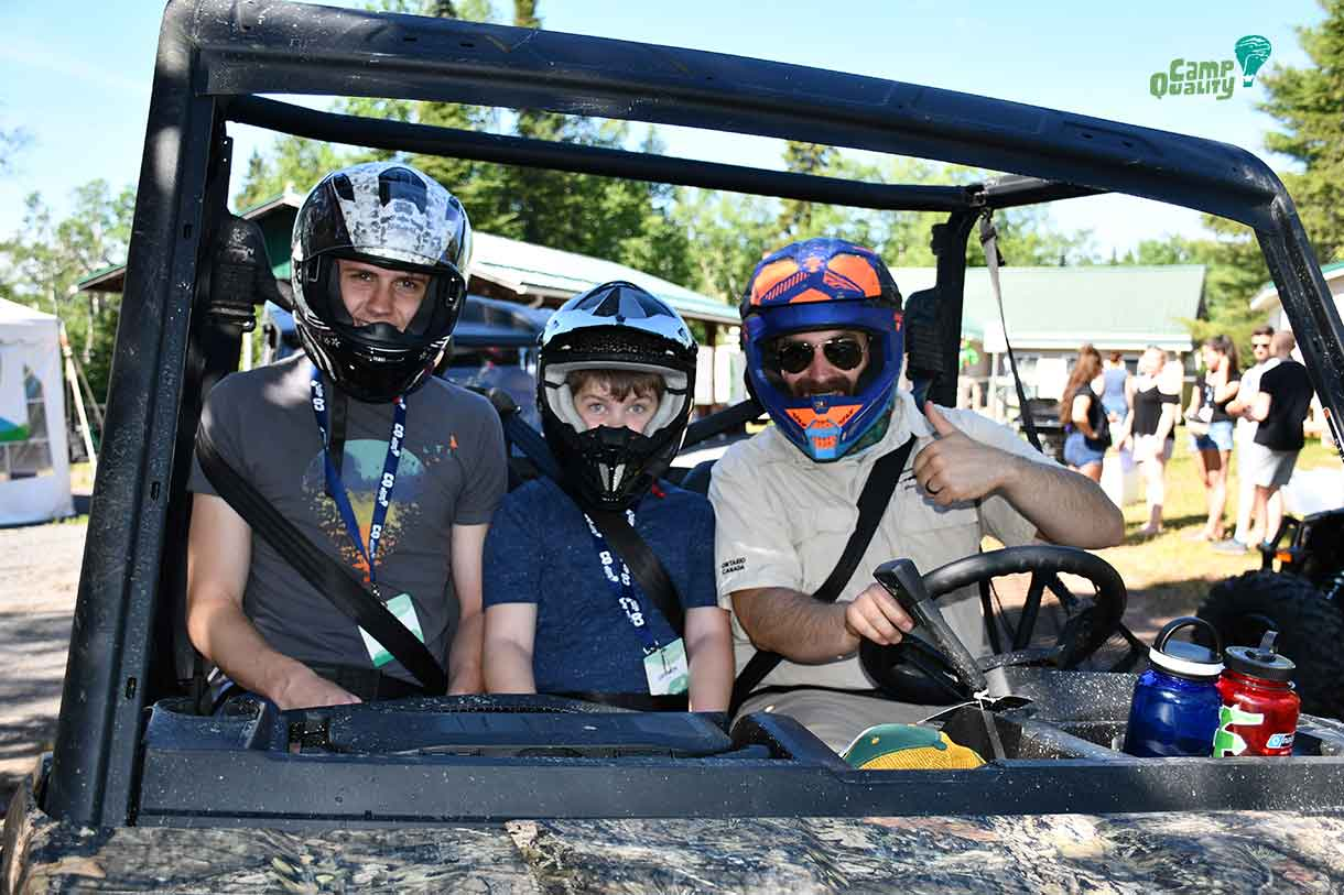 Companion Josh (left) and camper Gryphon (middle) taking a ride with Daniel (AKA Ranger Rick) through the safari!