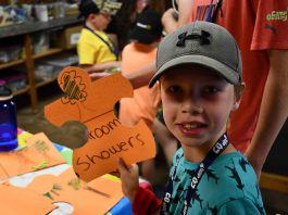 Camper Ryder shows off a piece of the Treasure Map Puzzle