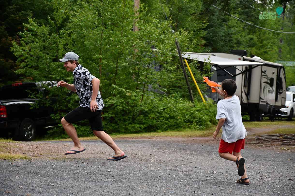 Camper Alessio chases his Companion Branden with a T-Rex water gun. Way to get into the theme, Alessio!
