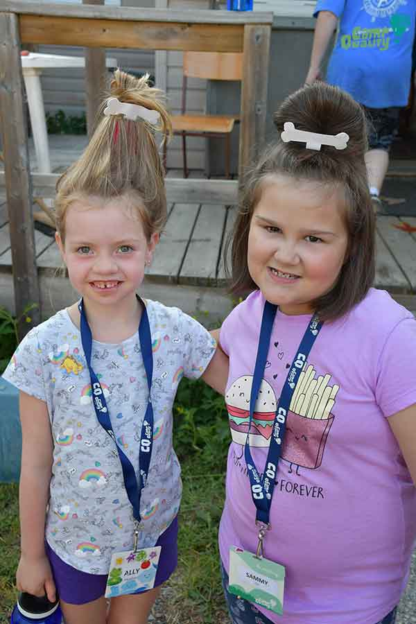 Campers Ally (left) and Sammy showing off their hair for tonight's themed dinner – Flintstone hair! Very creative, girls!