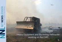 Heavy Equipment and Bucketing Helicopter working on Red 040