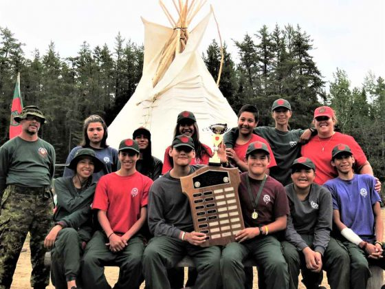 Some of the Mishkeegogamang Junior Canadian Ranger patrol at Camp Loon with the award for the province's best Junior Ranger patrol;.