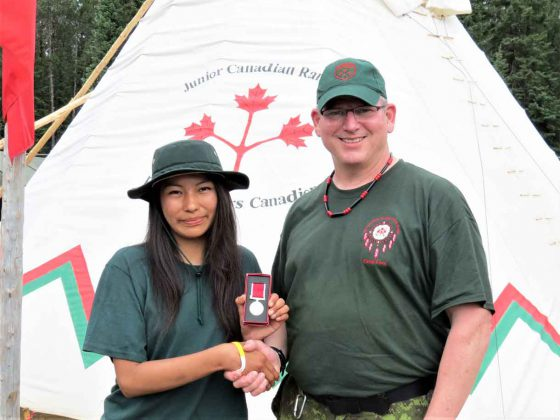 Junior Canadian Ranger Chasity Koosees of Kashechewan receives the Order of St.George Medal from from Lieutenant-Colonel Matthew Richardson.