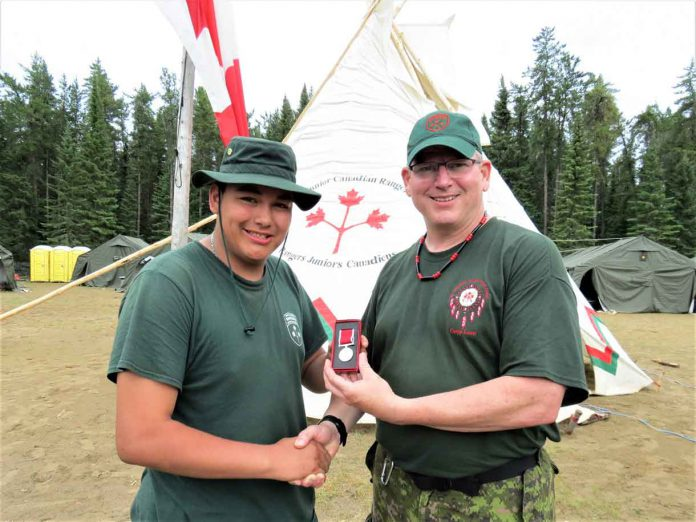 Junior Canadian Ranger Daniel Bottle, left, receives the Order of St. George Medal from Lieutenant-Colonel Matthew Richardson, who commands the Canadian Rangers of Northern Ontario. Photo by Sgt Peter Moon Canadian Rangers