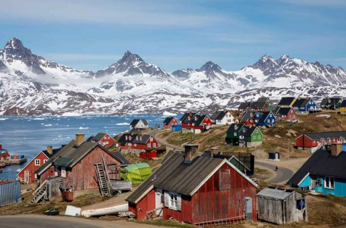 ARCHIVE PHOTO: Snow covered mountains rise above the harbour and town of Tasiilaq, Greenland, June 15, 2018. REUTERS/Lucas Jackson/File Phot