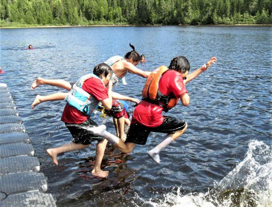 Junior Canadian Rangers take a leap into cooling water on a hot day at Camp Loon. Photo - Sgt Peter Moon Canadian Rangers