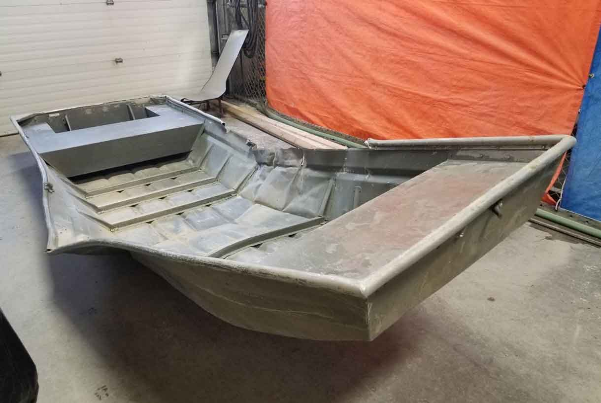 Damaged aluminum boat found by RCMP officers on the shores of the Nelson River during a helicopter search on friday afternoon.