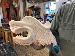Terry Hurtig of the Thunder Bay Carvers shows off some of the work
