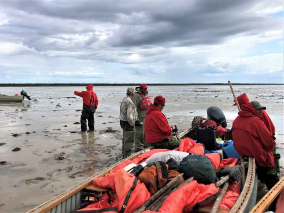 Canadian Rangers waiting for the tide to come in on James Bay so they can continue their patrol.