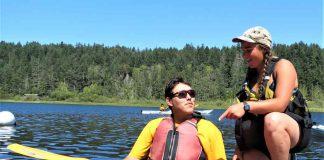 Junior Canadian Ranger Wilbert Shisheesh of Attawapiskat receives kayaking instructions from Maia Beauvais, a boating instructor.