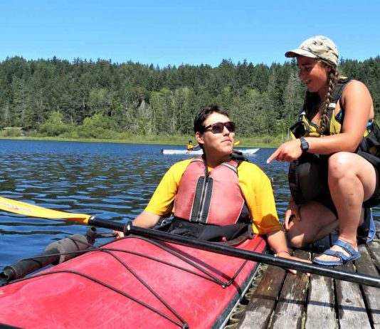 Junior Canadian Ranger Wilbert Shisheesh of Attawapiskat receives kayaking instructions from Maia Beauvais, a boating instructor.