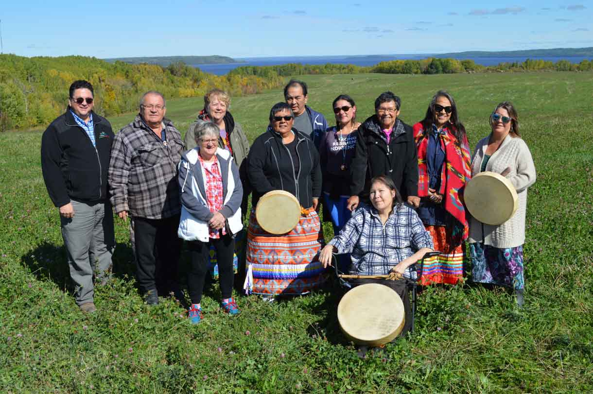A Language Gathering that brother together Indigenous language speakers was held near North Cobalt, near Temiskaming and overlooking Lake Timiskaming from September 27 to 29. Pictured from L-R are representatives who made the event possible: Dani Grenier-Ducharme, District of Timiskaming Social Services Administration Board; Elder George Ethier, Temiskaming Metis Council; Elder Freda Wabie (in front), Beaverhouse FN; Elder Marie Liliane Ethier, Temiskaming Metis Council; Bertha Cormier, Matachewan FN; Elder Tom Wabie, Beaverhouse FN; Melissa Gill, Temiskaming Native Women's Support Group (TNWSG); Elder Vina Hendrix, Matachewan FN; Elder Roberta Oshkabewisens, TNWSG and Nancy Wabie, Beaverhouse FN. Seated in front is past Beaverhouse FN Chief, Elder Sally Susan Mathias Martel (Marcia Brown-Martel).