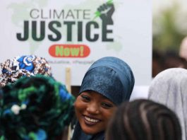 A protester smiles during a demonstration for climate protection in Abuja, Nigeria September 20, 2019. REUTERS/Afolabi Sotunde