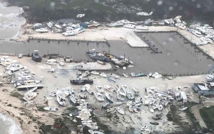 An aerial photo shows damage from Hurricane Dorian over an unspecified location in the Bahamas, September 2, 2019. Courtesy Coast Guard Air Station Clearwater/U.S. Coast Guard/Handout via REUTERS