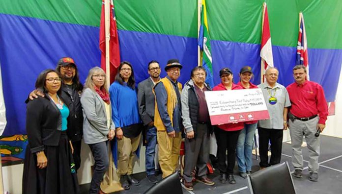 From left to right: Wanda Atlookan-Sugarhead/Council Member, Harry Papah, Elizabeth Atlookan/Past-Chief, Hannah Waswa/Council Member, Andrew Yesno/Council Member, Louis Sugarhead/Council Member, Charlie Okeese/Council Member, Lena Shawinimash/NSA Agent, Maureen Massaro/Director of Passenger Services/NSA, Chief Harvey Yesno, Tom Meilleur/VP/NSA.