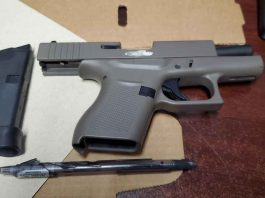 Police seized this handgun which was loaded from one of the suspects