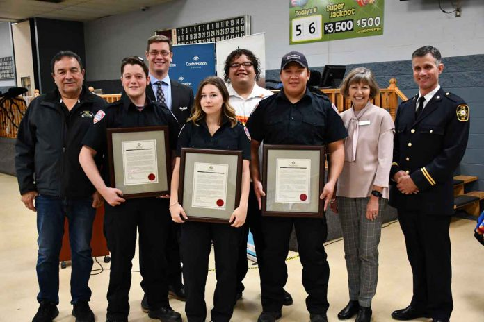 Three Confederation College Pre-Service Firefighter graduates received recognition for heroism from the Ontario Fire Marshal Saturday. From left: · Chief Peter Collins, Fort William First Nation · Riley Tucker, Recipient · Shane Strickland, Dean, School of Health, Negahneewin and Community Services, Confederation College · Taya Stamler, Recipient · William Solomon, Volunteer Fire Service Lead, Fort William First Nation · Devon Wanakamik, Recipient · Kathleen Lynch, President, Confederation College · Tim Beebe, Northern Training Officer, Office of the Ontario Fire Marshal and Emergency Management