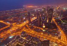 Dubai night skyline. Dubai streets by night. Al Yaqoub tower Dubai. Dubai Millennium Plaza. Dubai Sheikh Zayed Road by night. Dubai night view. Dubai cityscape by night. Dubai metro station view.