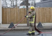 Thunder Bay Fire Rescue - Firefighter cleaning up on Simpson Street