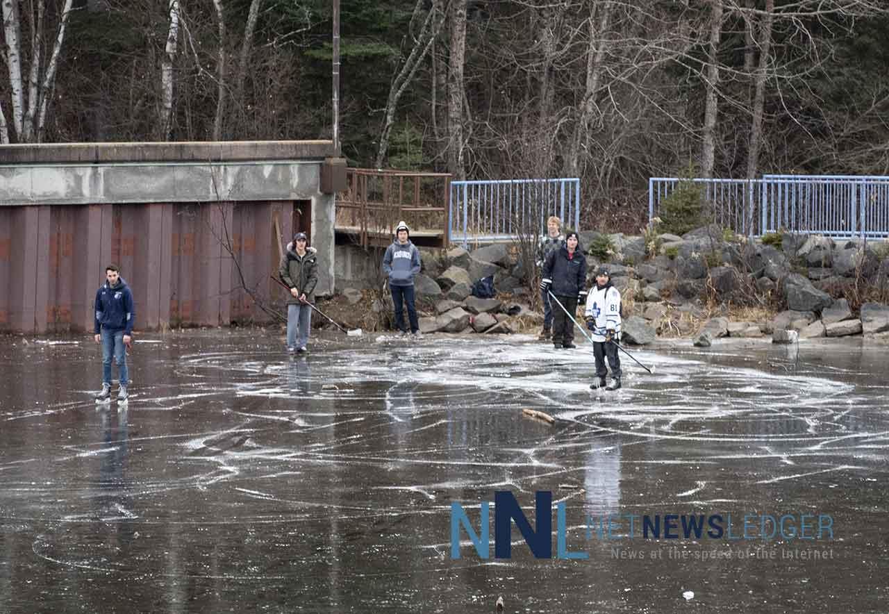 Skaters at Lakehead University enjoying the ice on Lake Tamblyn.