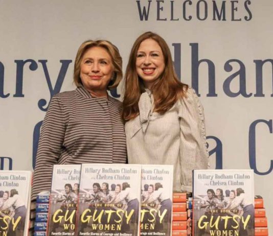 """Hillary Clinton and Chelsea Clinton pose for pictures during an event for their new book """"The Book of Gutsy Women"""" in the Manhattan borough of New York City, New York, U.S., October 3, 2019. REUTERS/Jeenah Moon"""