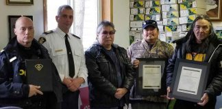 (left to right): P/C Jean DUGUAY, S/Sgt Karl DUEWEL, Chief Brennan SAINNAWAP, Dwayne BROWN, and Band Councillor Clifford BEARDY.