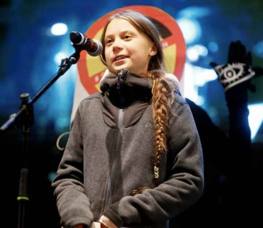 Climate change activist Greta Thunberg delivers a speech at a climate change protest march, as COP25 climate summit is held in Madrid, Spain, December 6, 2019. REUTERS/Javier Barbancho