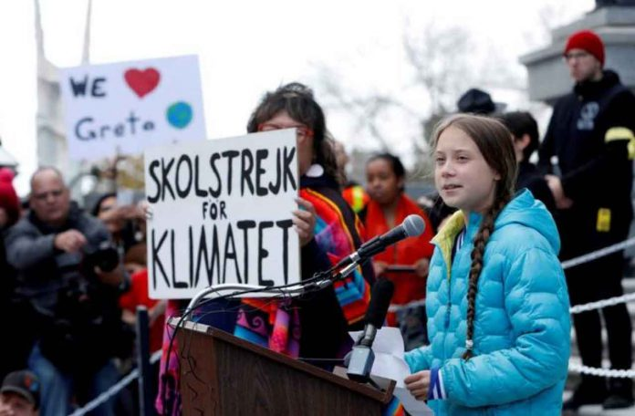 Swedish climate change teen activist Greta Thunberg speaks during a climate strike at the Alberta Legislature in Edmonton, Alberta, Canada October 18, 2019. REUTERS/Amber Bracken/File Photo