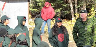 Lieutenant-Colonel Shane McArthur, right, talks with new Junior Canadian Rangers in Pikangikum First Nation