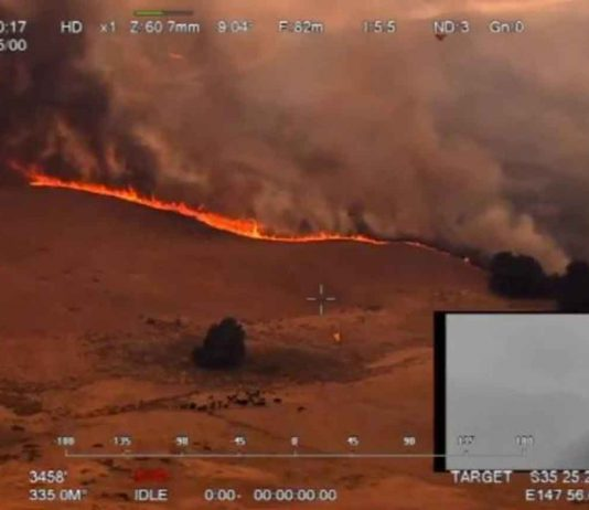 An aerial view of a bushfire in Ellerslie, New South Wales, Australia December 30, 2019 in this still image obtained from social media video. NSW RURAL FIRE SERVICE/via REUTERS