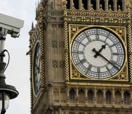 ARCHIVE PHOTO: A surveillance camera points towards Parliament Square, in front of the Big Ben Clock Tower in London October 18, 2010. REUTERS/Luke MacGregor