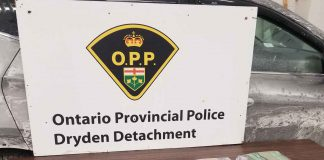 Dryden OPP Seize Stacks of Cash - Two Face Pile of Charges