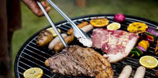 Barbecues steaks on a charcoal grill