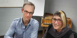 Music Director Paul Haas and President Linda Penner sign contract renewal at Thunder Bay Symphony office