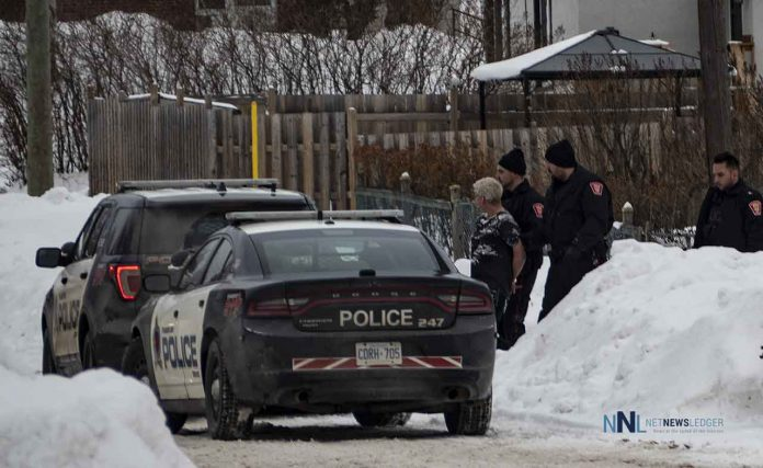 Thunder Bay Police officers with a suspect in custody after a manhunt on McCulloch Street.