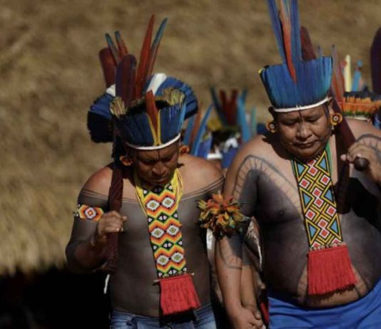 Indigenous people of Tapirape tribe, perform a greeting dance during a four-day pow wow in Piaracu village, in Xingu Indigenous Park, near Sao Jose do Xingu, Mato Grosso state, Brazil, January 14, 2020. REUTERS/Ricardo Moraes