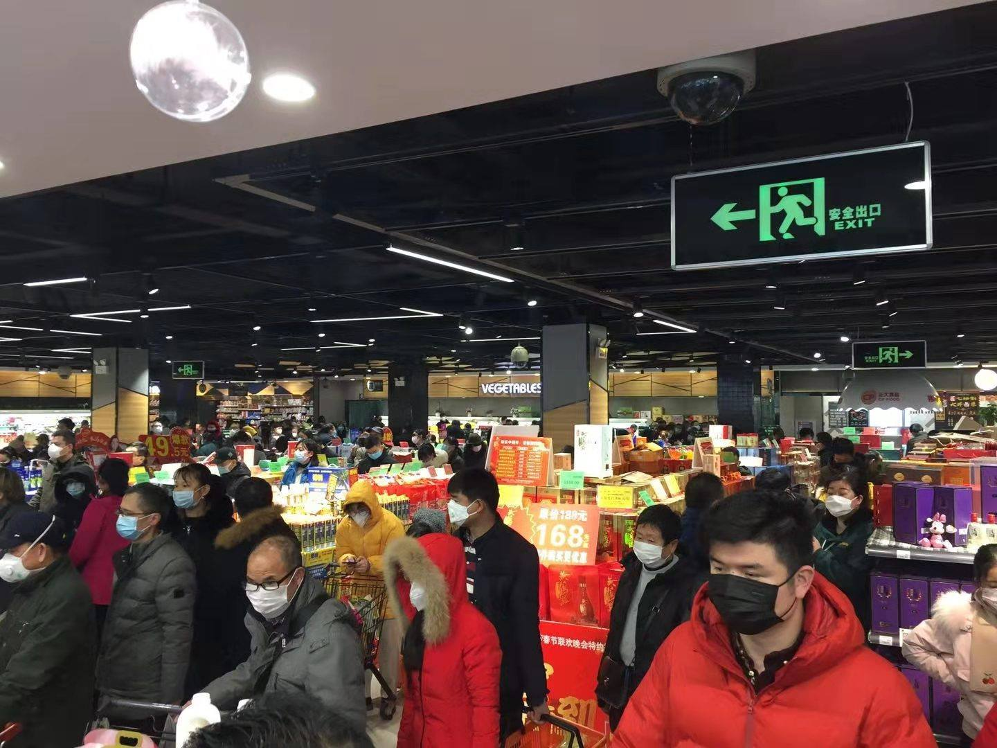 Shoppers a week ago at Wushang Market. Its a stote similar to a Walmart but on a smaller scale.