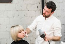 Woman Getting Her New Hairstyle In Salon.
