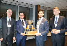Justis Danto-Clancy, second from left, and Justin Blanco, third from left, were presented with the Arnup Cup by the Hon. Justice Clayton Conlan, left, and the Advocates' Society's President Scott Maidment.