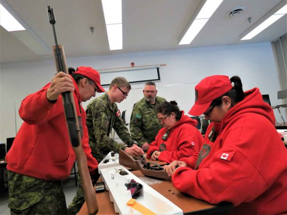 Canadian Rangers learn about the new air rifle used to teach Junior Rangers marksmanship and firearm safety.