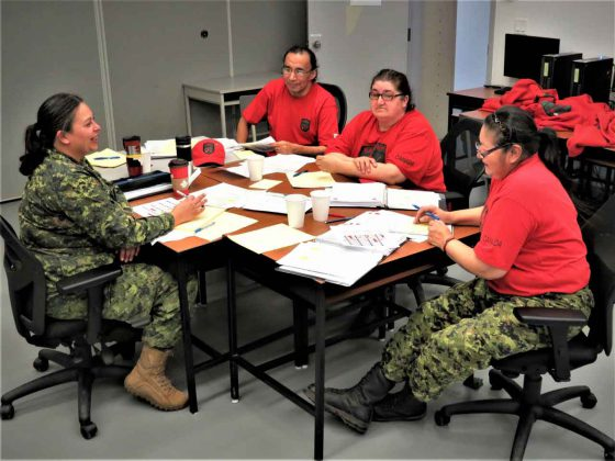 Sergeant Eva Clarke, an army instructor, left, leads a discussion with, from left, Master Corporals Floyd Fiddler from Sandy Lake, Linda Kanate from North Caribou Lake, and Kathleen Beardy from Muskrat Dam.
