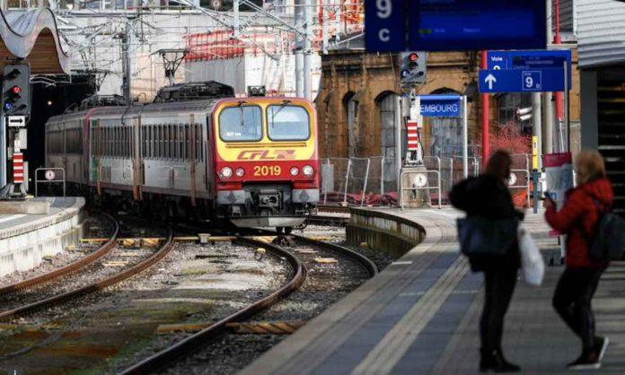 Passengers wait on a platform as a train arrives at Luxembourg railway station, February 29, 2020. REUTERS/Francois Lenoir