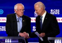 Democratic 2020 U.S. presidential candidates Senator Bernie Sanders shakes hands with former Vice President Joe Biden after the tenth Democratic 2020 presidential debate at the Gaillard Center in Charleston, South Carolina, U.S., February 25, 2020. REUTERS/Jonathan Ernst/File Photo