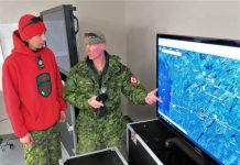 Corporal Earl Wesley of Long Lake # 58 First Nation, left, checks patrol routes on a map with Warrant Officer Christopher Thomson, an army instructor.